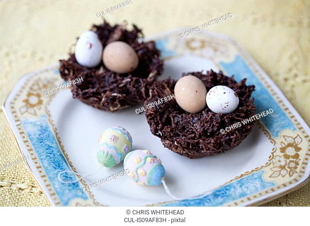 Still life of chocolate easter eggs in chocolate nests
