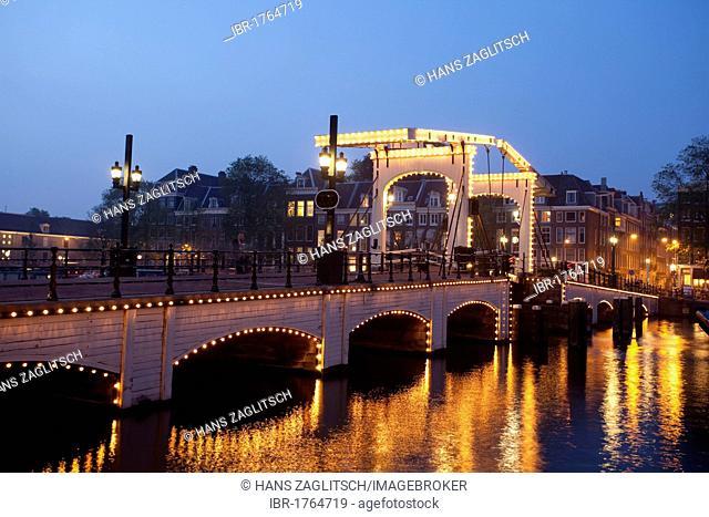 Magere Brug bridge over the Amstel river, Amsterdam, Holland, Netherlands, Europe
