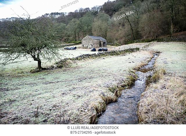 Rural landscape with frost, a creek, barn, and trees. Buckden, Skipton, Norht Yorkshire, England