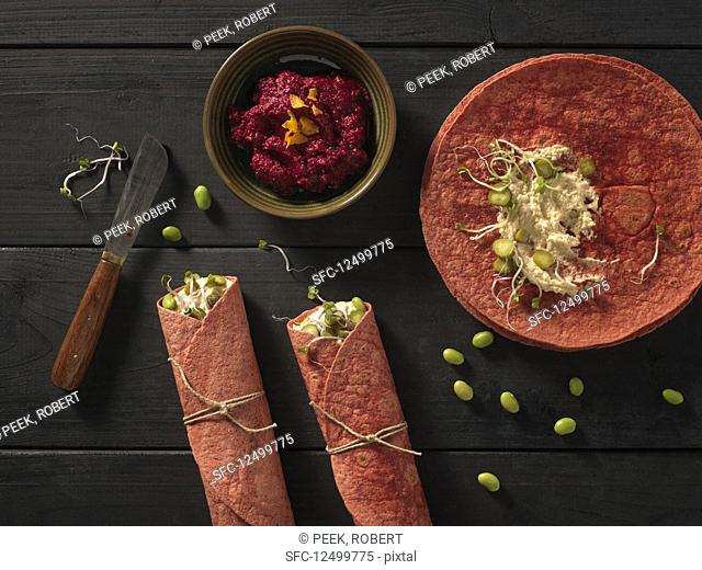 Beetroot wraps with hummus, edamame and sprouts