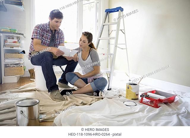 Couple with paint swatches starting painting project