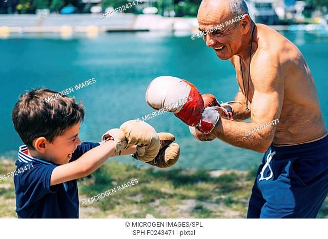 Grandfather and grandson boxing