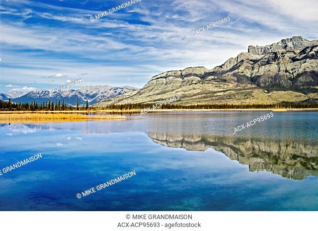 Rocky Mountains reflected in Talbot Lake, Jasper National Park, Alberta, Canada