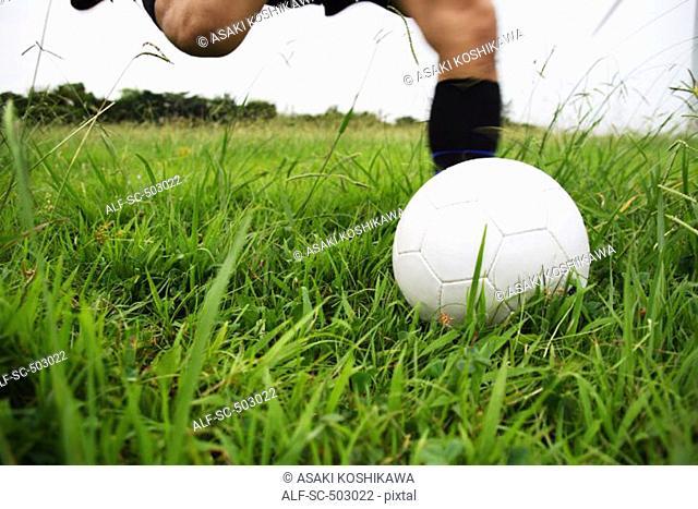 Soccer Player Running To Kick A Soccer Ball