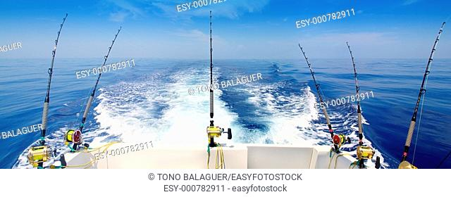 boat fishing trolling panoramic rod and reels blue sea wake