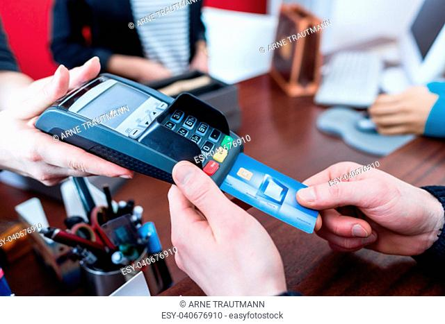 Customer paying with credit card in shop or store