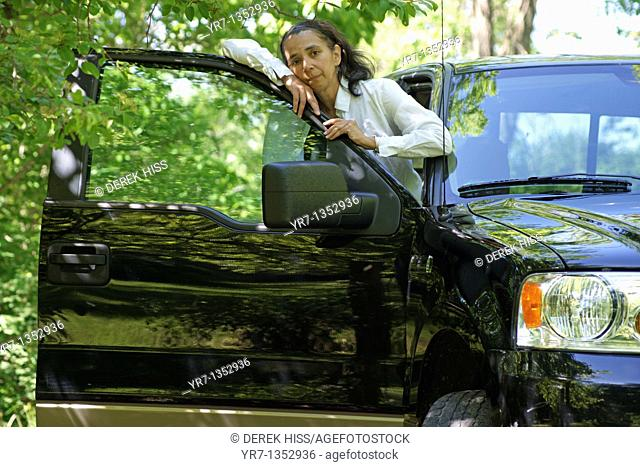 Mature woman in pickup truck