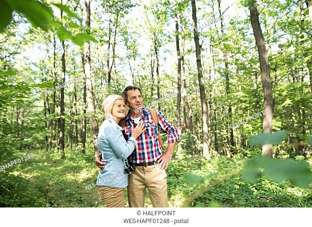 Senior couple watching something in the woods