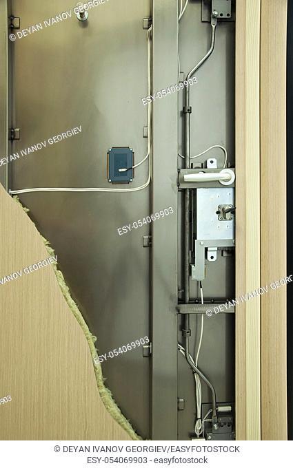 Exposed mechanism of armored door