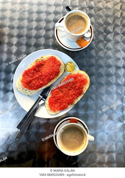 Spanish breakfast: sliced bread with tomato and olive oil with two cups of coffee. Spain