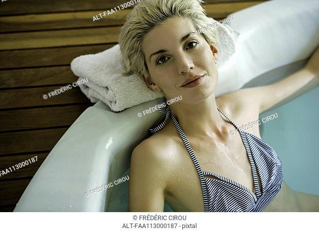 Woman soaking in tub