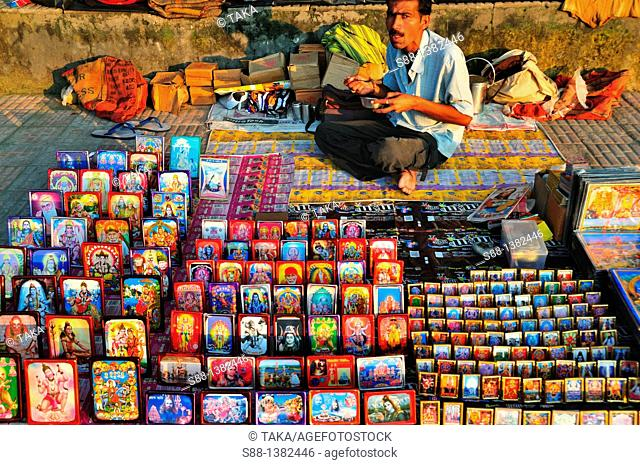 Man selling pictures of Gods at Har Ki Pairi ghat by the Ganges river
