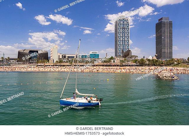 Spain, Catalonia, Barcelona, the Barceloneta beach, in the background or the Peix Ballena (Whale) by Frank O. Gehry, the towers of the Hotel Arts and Mapfre...