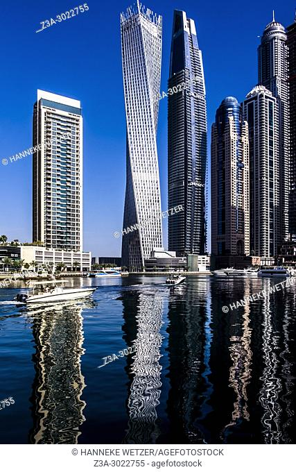 Abstract water reflection of the Iris Blue Tower at Dubai Marina, Dubai, UAE