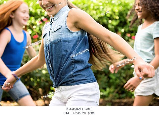 Smiling girls running outdoors