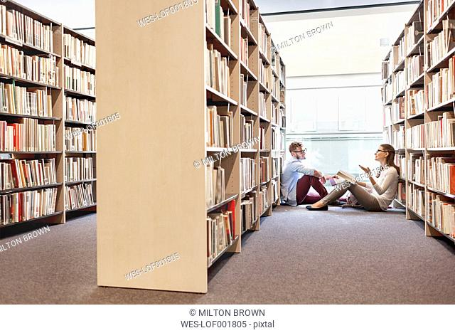 Two students learning at university library