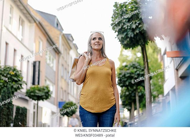 Portrait of smiling woman with shopping bags