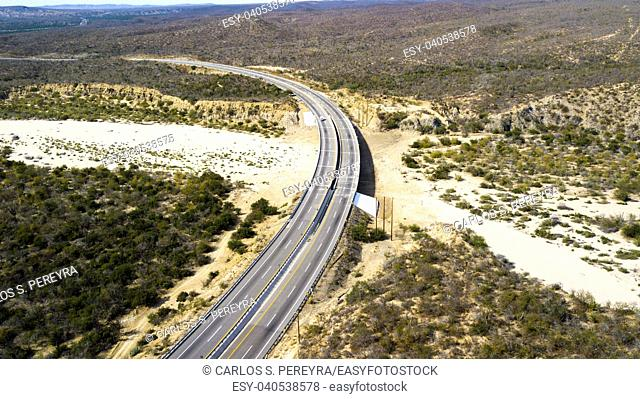 Aerial view of a highway crossing the desert of the peninsula of Baja California in Mexico
