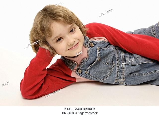 Eight-year-old girl lying on the floor