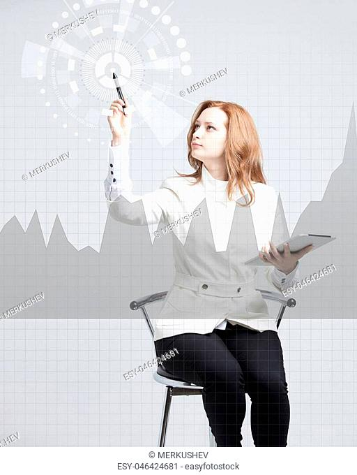 Young businesswoman with stylus working with graph chart. Future technologies for busines, stock market concept
