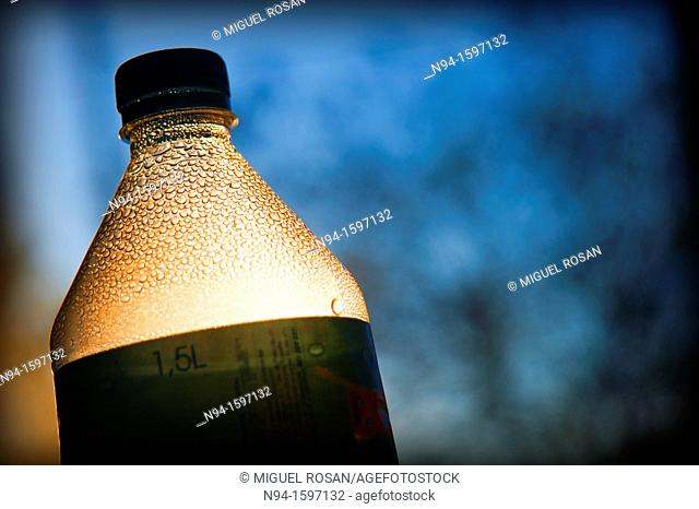 Top of a bottle to the light, bottled mineral water
