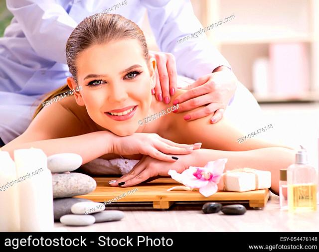 The young woman during spa procedure in salon