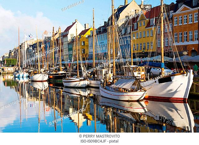 Moored boats and colourful 17th century town houses on Nyhavn canal, Copenhagen, Denmark