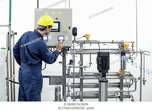 Worker operating industrial equipment