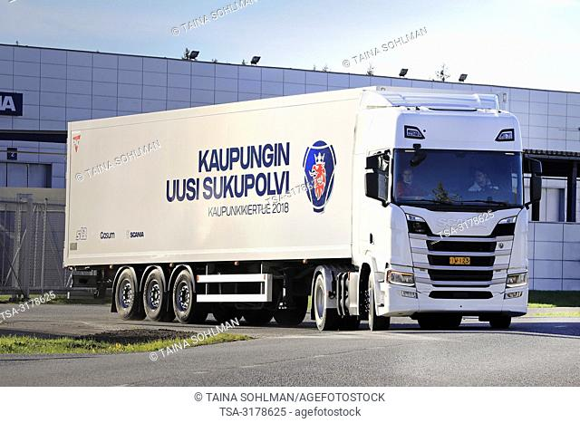 Lieto, Finland - October 19, 2018: White Scania R410 A4x2NB semi truck with new 13-litre gas engine on test drive on Scania Urban Tour 2018 Turku