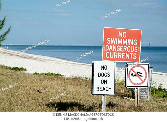 No swimming Signs on beach regulate the actions of patrons to Fort Desoto County Park at St Petersburg Florida