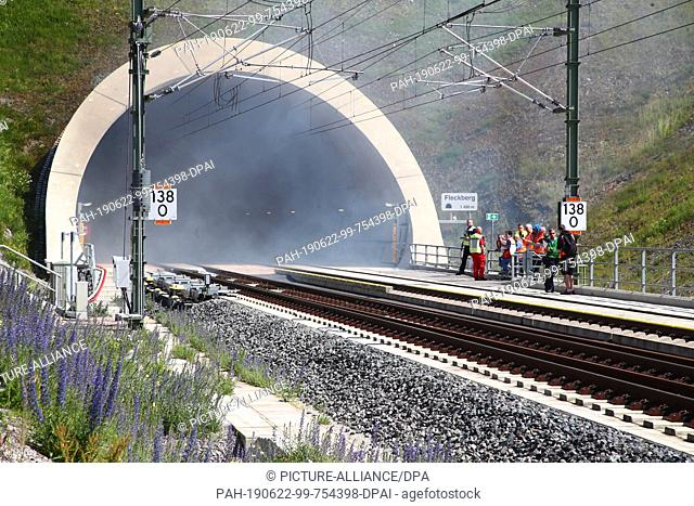 22 June 2019, Thuringia, Goldisthal: Smoke comes out of the Fleckberg tunnel during an emergency exercise. Emergency forces rehearsed the rescue operation on...