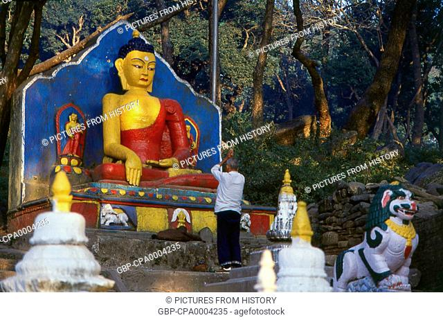 Nepal: Pilgrim and Buddha figure, Swayambhunath (Monkey Temple), Kathmandu Valley