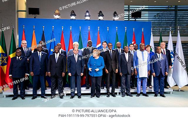 19 November 2019, Berlin: Federal Chancellor Angela Merkel (M, CDU) together with Nana Addo Dankwa Akufo-Addo (l-r), President of Ghana, Philippe le Houerou