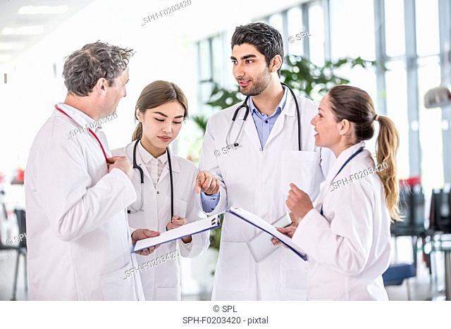 Medical colleagues with clip boards