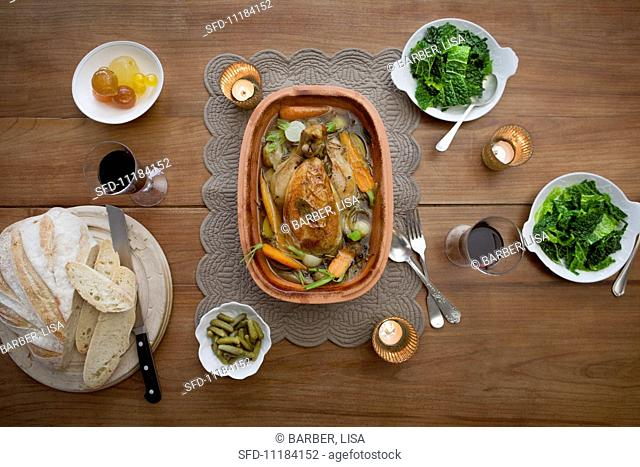 Stuffed chicken with vegetables in a clay pot, with savoy cabbage, white bread and mostarda di frutta (Italian condiment made of candied fruit and a mustard...