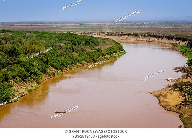 A Boat Crosses The Omo River In The Remote Omo Valley Region Of Southern Ethiopia