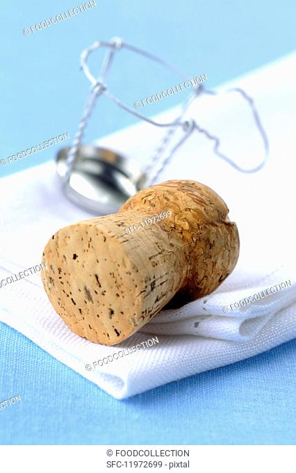 Champagne cork and a wire cork holder
