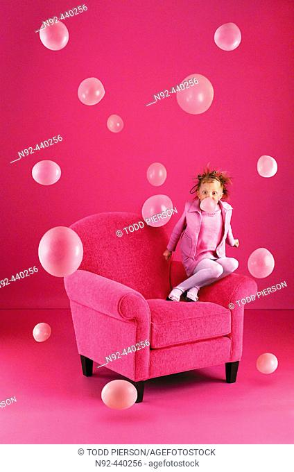 6 year old girl blowing bubbles