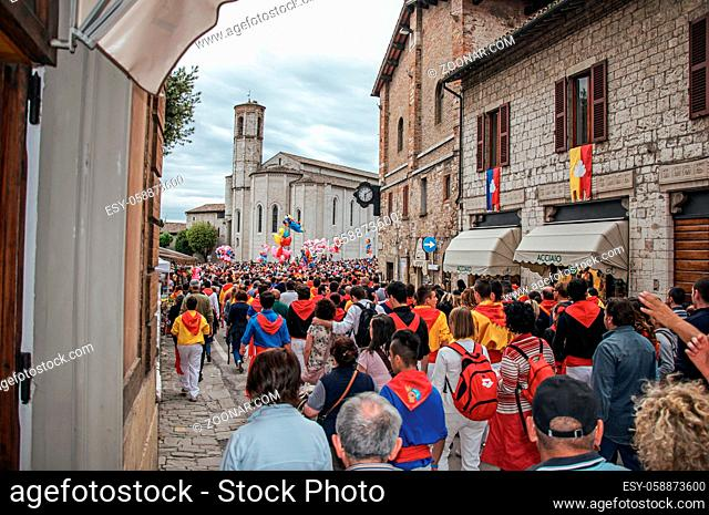 Gubbio, Italy - May 15, 2013. Colorful crowd participating in the Feast of Ceri, a traditional event of the city of Gubbio, a well preserved medieval town