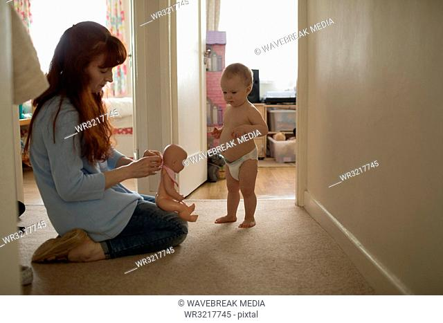 Mother and baby girl playing with toy