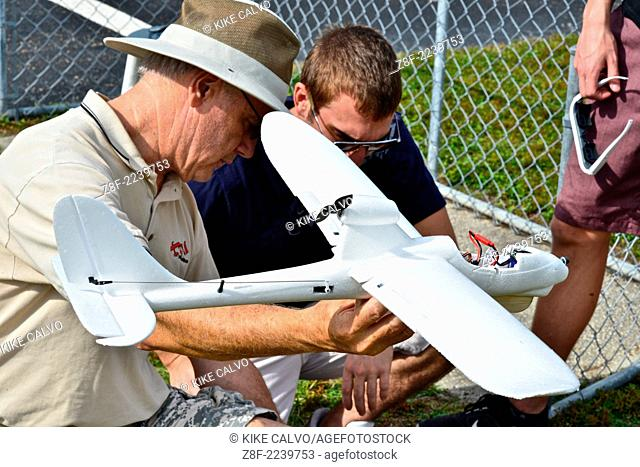 Students learn to fly fixed-wing RC planes at a small unmanned aircraft pilot training course at the Unmanned Vehicle University