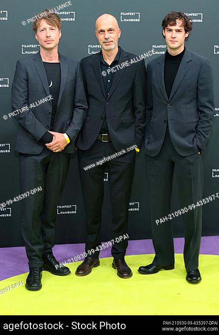 30 September 2021, Hamburg: Author Thomas Reider (l-r), director Sebastian Meise and actor Thomas Prenn come to the 29th Hamburg Film Festival