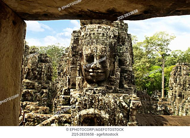 Face towers of the Bayon temple, In the center of Angkor Thom , Siem Reap, Cambodia. UNESCO World Heritage Site. Capital city of the Khmer empire built at the...