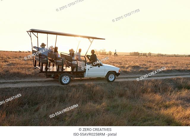 People on safari in off road vehicle, Stellenbosch, South Africa