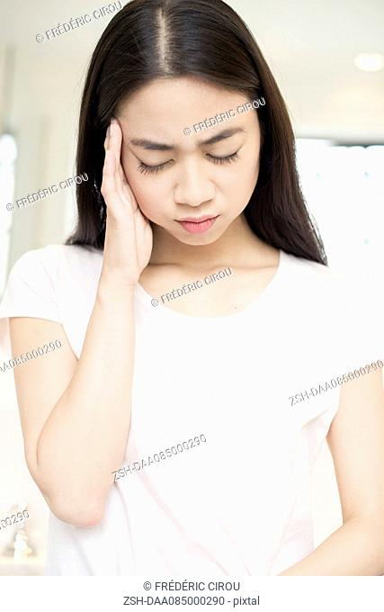 Woman suffering a headache