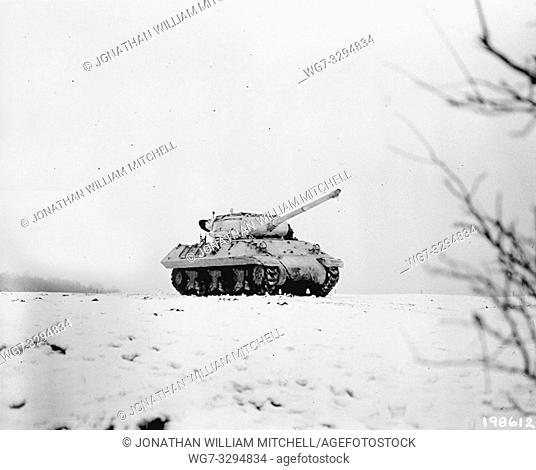 LUXEMBOURG Dudelange -- 03 Jan 1945 -- Painted white to blend with the snow-covered terrain, an M-36 tank destroyer crosses a field
