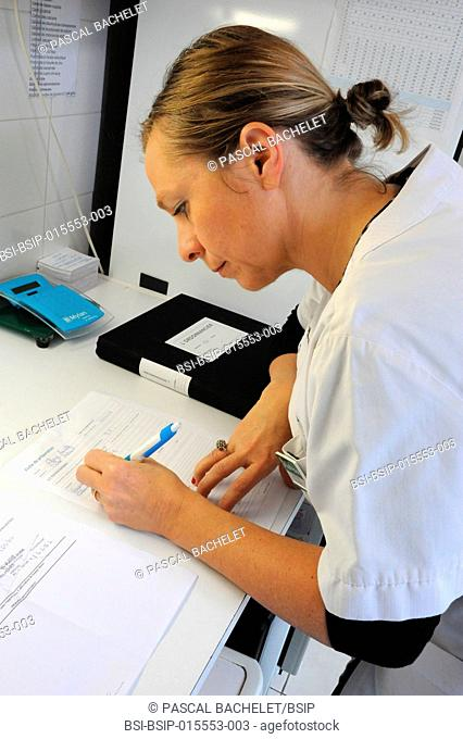 Reportage in a pharmacy in Auxi-le-Château, France. A pharmacy technician prepares a glycerol starch-based treatment. Preparation sheet