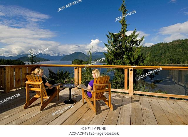 Friends enjoy a beautiful fall day at West Coast Wilderness Lodge in Egmont on the Lower Sunshine Coast, Vancouver coast and mountain region, British Columbia