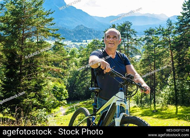 Senior man with e-bike