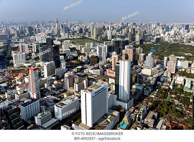 View from Maha Nakhon Tower, 314m, city panorama, Pathumwan and Watthana district, Lumphini Park, Bangkok, Thailand